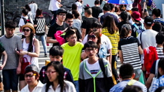 Crowd cross the street in the downtown of Beijing, China.slow motion Stock Footage
