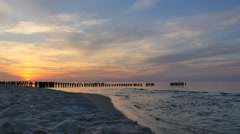 Baltic Sea and the breakwater at sunset Stock Footage