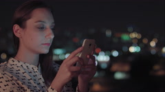 A beautiful woman using your cellphone to send a mesage Stock Footage