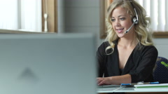 Young female customer service representative working and smiling Stock Footage
