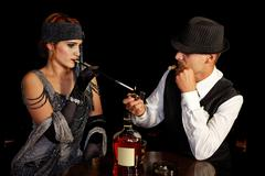 Flapper girl and gangster - stock photo
