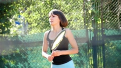 pretty girl goes in for sports, tennis, slow motion 5 - stock footage