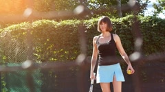 Pretty girl goes in for sports, tennis, slow motion 4 Stock Footage