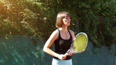 Pretty girl goes in for sports, tennis, slow motion 3 Stock Footage
