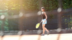 Pretty girl goes in for sports, tennis, slow motion 2 Stock Footage