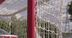 Slow motion summer sport - Ball hockey on the street Stock Footage