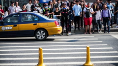 Crowd cross the street in the downtown of Beijing, China. Stock Footage