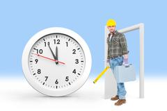 Composite image of manual worker with spirit level and toolbox - stock photo