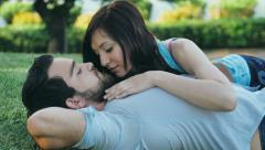 Couple in love on the grass: lovers in the park Stock Footage