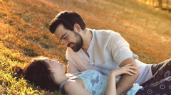 Couple in love at the sunset on the park Stock Footage