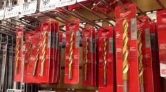 Man buying  titanium drill Stock Footage