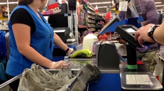 Man paying foods by credit card at Walmart checkout counter Stock Footage