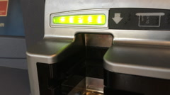 ATM card slot at debit machine status light blinking green - stock footage