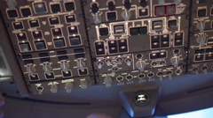 Airline pilot switching controls on overhead panel in a 747 cockpit 4K - stock footage
