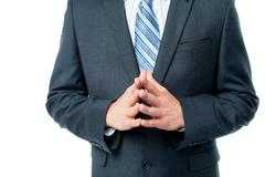 Clasped hands of businessman - stock photo