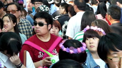 Close up of people walking in the shopping street, Beijing, China Stock Footage