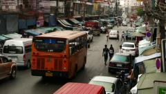 Inner-city road, cars parked at prohibitory sign, ambient noises, street market - stock footage