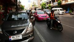 Thai woman open driver door of an car and sit inside, glide shot on lively road Stock Footage