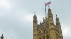 Bristish flag on Westminster Palace Victoria Tower, London City Stock Footage