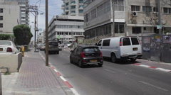 Street in Tel-Aviv, tilt up to Hotel Stock Footage