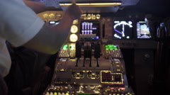 Fast-moving hand-held clip of airline pilot's hand using throttle 4K Stock Footage