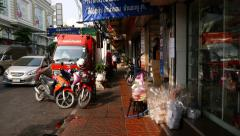 POV walk along narrow pavement, Thai people suddenly appear on the way Stock Footage