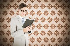 Stock Photo of Composite image of geeky businessman reading black book