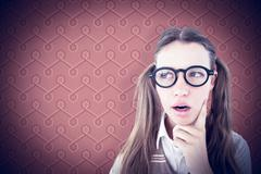 Stock Photo of Composite image of female geeky hipster looking confused
