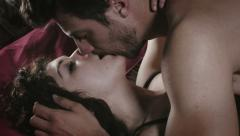 Lovers making love on the bed: people having sex in bedroom Stock Footage