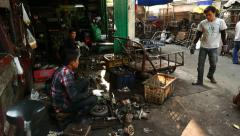 Car parts junkyard and workhouse, man disassemble hardly used oily spares - stock footage