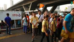 Lot of people debark from express boat at the wharf, tourists and local Thai Stock Footage