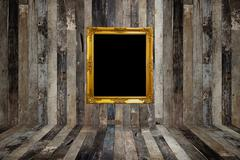 Golden photo frame in old room Stock Photos