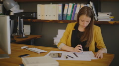 Business Woman Architect drawing checks, measuring compasses Stock Footage