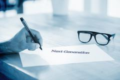 Next generation against side view of hand writing on white page on working desk - stock illustration