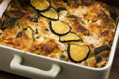 casserole with cheese and zucchini in baking dish - stock photo