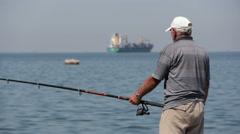 City harbor fisherman Stock Footage