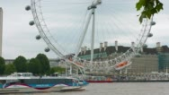 Stock Video Footage of Establishing shot of tourist boat on River Thames and London Eye Wheel