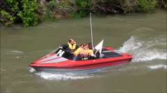 Jetboat holds position in river Stock Footage