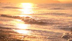 Sea waves at sunrise. Slow motion. - stock footage