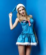 Beautiful fashion woman in Snow Maiden suit poses on blue background Stock Photos