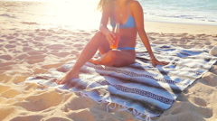 Beautiful Attractive Young Woman Sitting on the Beach. - stock footage