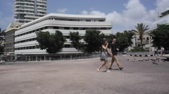 People walk next to renovated bauhaus at Dizengoff Sqaure in Tel-Aviv Stock Footage