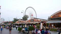 Lively Asiatique riverside promenade in dusk, camera move backwards Stock Footage