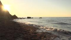 Sunrise over the rocks . Morning seaside promenade. Stock Footage