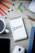 Next generation against notepad on desk - stock illustration
