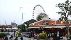 Asiatique promenade at from Chao Phraya river embankment, POV backward move shot Stock Footage