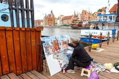 Gdansk. Artist on the central waterfront. Stock Photos