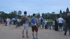 Pan -tourists waiting at Angkor wat for the sunrise Stock Footage