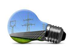 Solar panels with pylons in light bulb Stock Photos