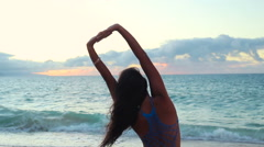 Surfing surfer woman babe beach fun at sunset. - stock footage